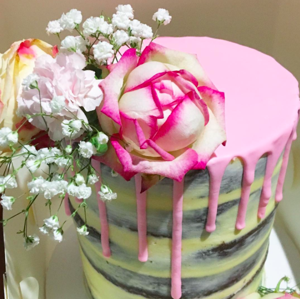 Naked cake with bright pink drip