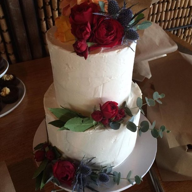 Buttercream Wedding Cake with Red Flowers