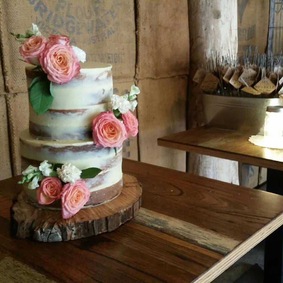 Naked Wedding Cake with Pink Flowers