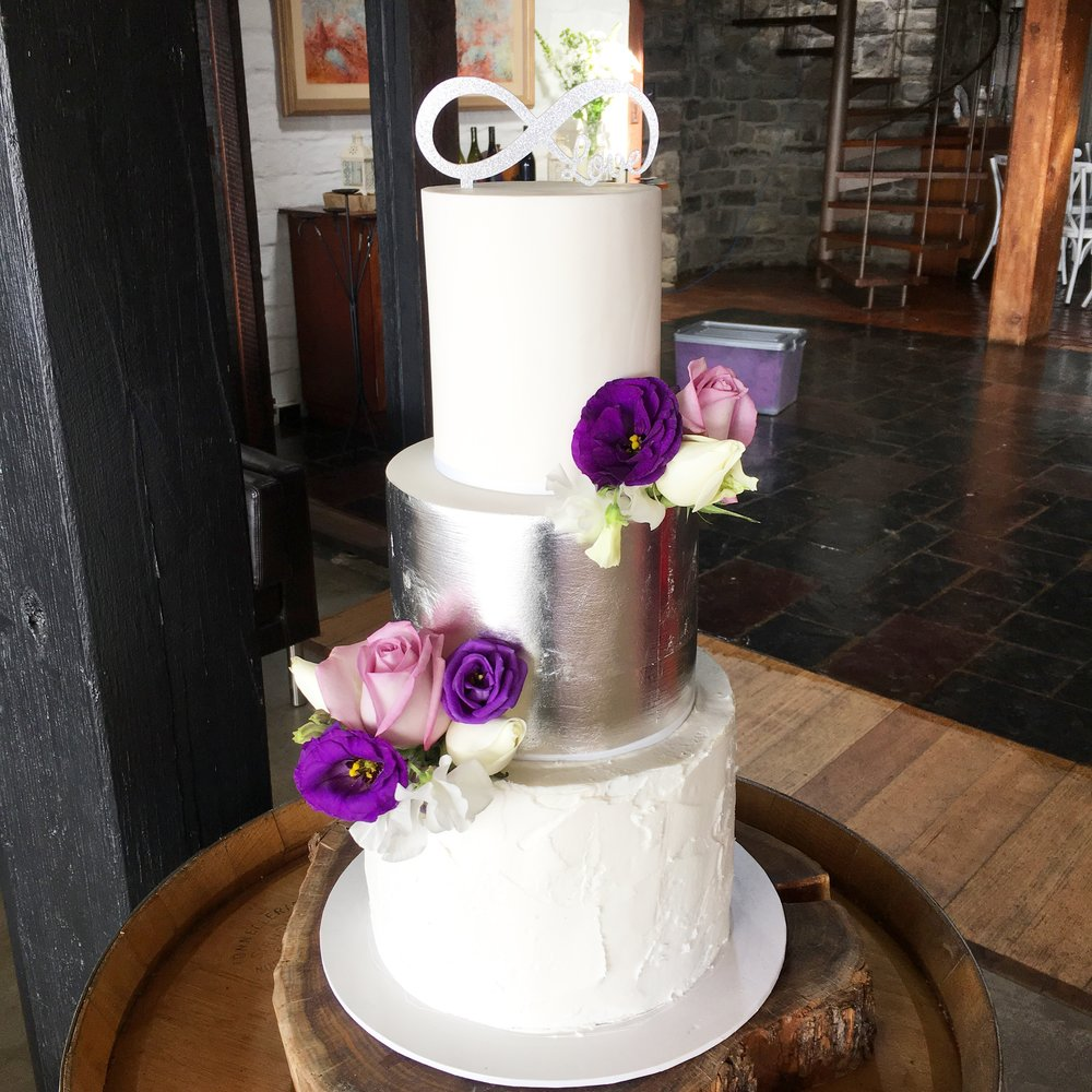 White & Silver Leaf Wedding Cake with Fresh Flowers