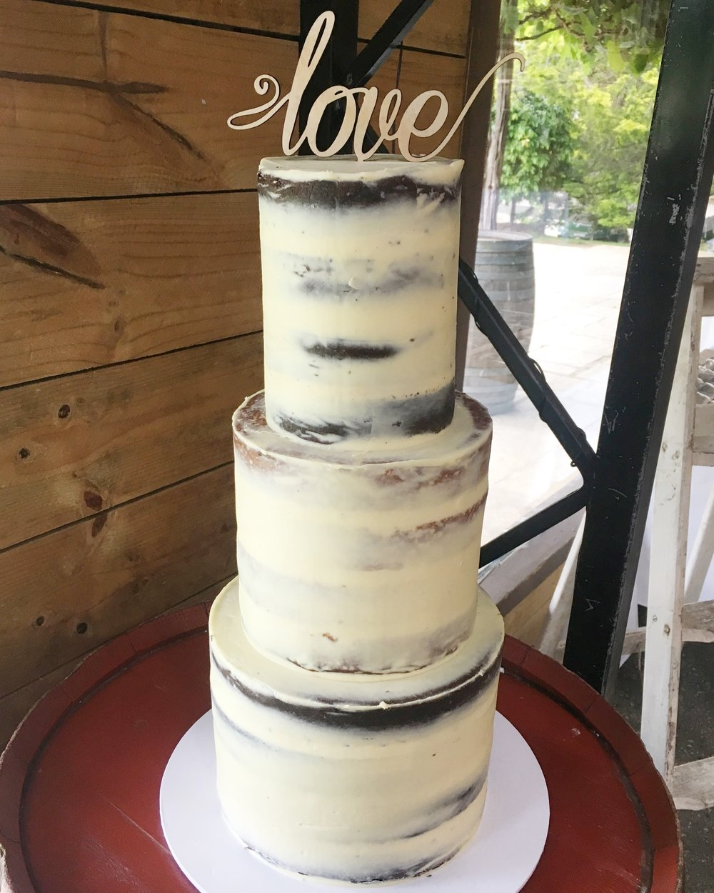 Naked Wedding Cake with 'Love' Topper