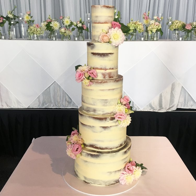 "12""/10""/8""/6""/4""  Tea & Coffee Serves: 270-280 Dessert Serves: 135-140   Naked  starts from $1012 plus  Delivery . Click  here  to enquire.    Buttercream  starts from $1075 plus  Delivery . Click  here  to enquire.   Custom Cakes & Fondant Finish starts from: $1100 plus  Delivery . Click  here  to enquire."
