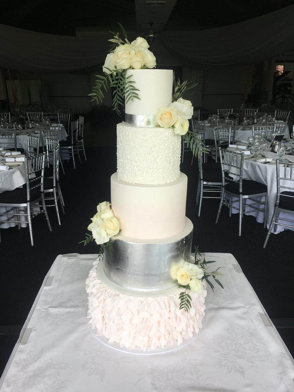 White Wedding Cake with Ruffles