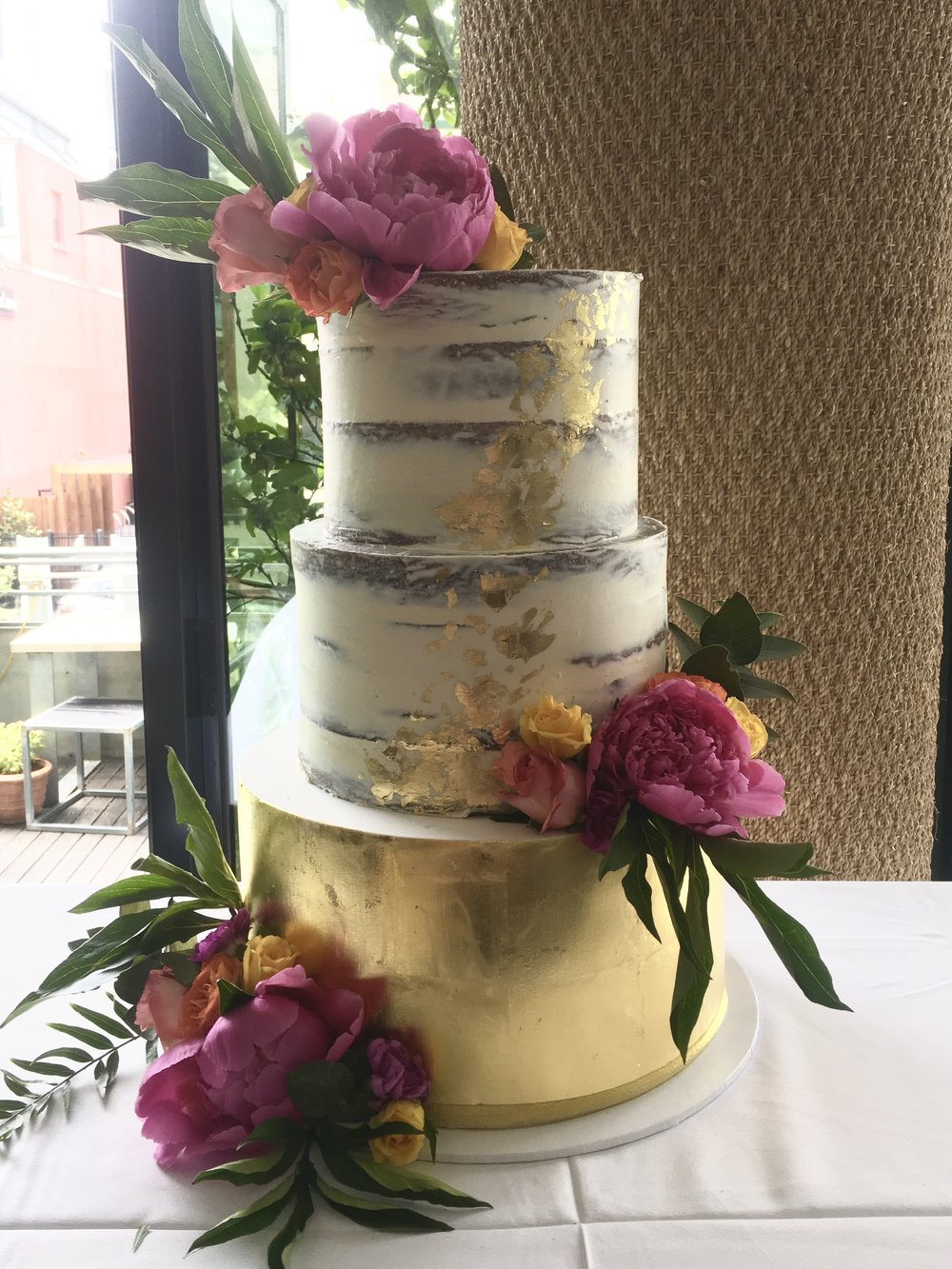 Naked Wedding Cake with Gold Leaf