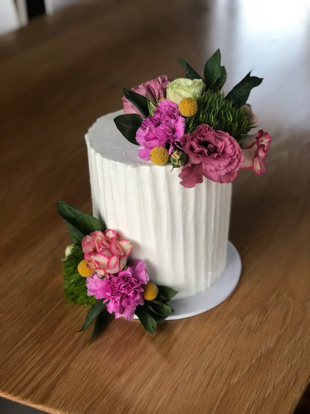 Buttercream Cake with Bright Flowers