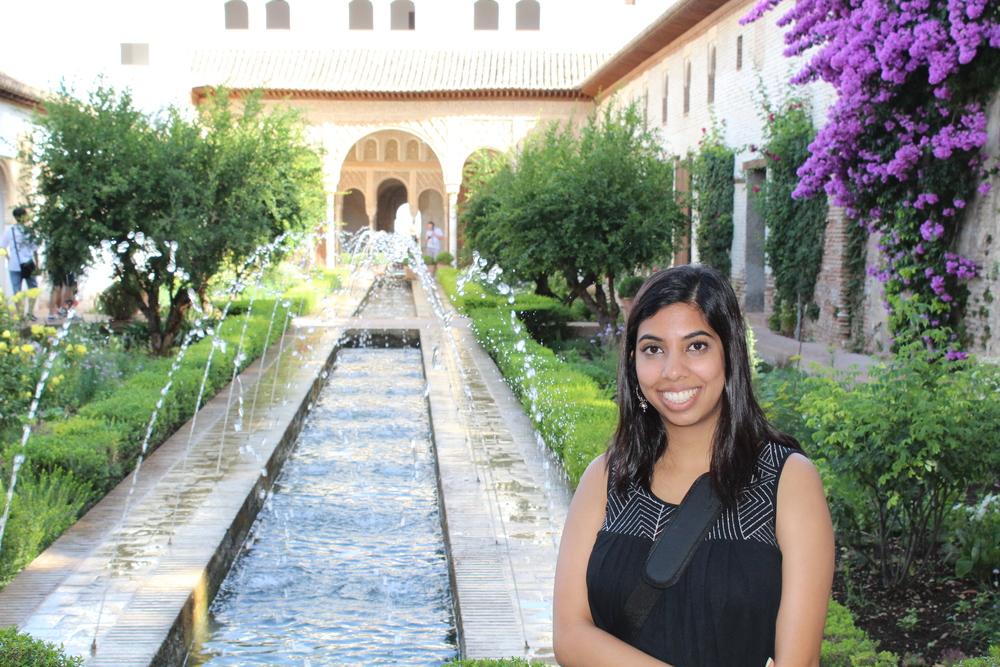 Meherin Huque (M2) traveled to Spain and Portugal this summer. This is her at the gardens of Alhambra in Granada, Spain. Even though it was over 100 degrees outside, the trees and reflecting pools kept the gardens cool.