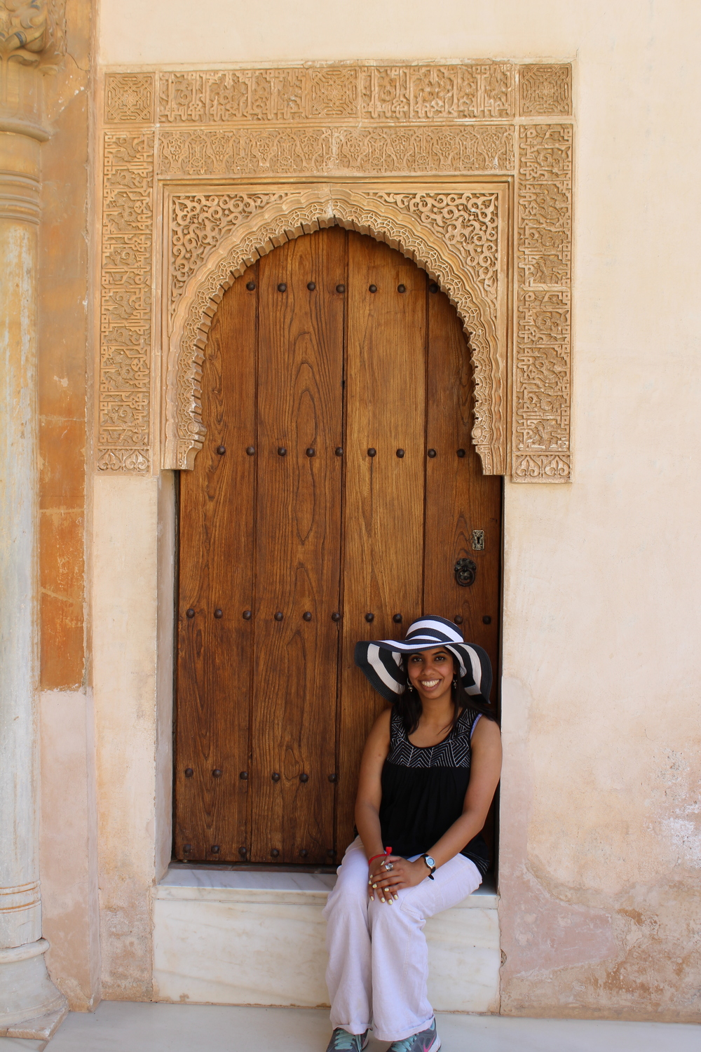 Meherin Huque (M2) traveled to Spain and Portugal this summer. This door is at Nasrid Palace in Alhambra. The doorway is intricately carved from marble.