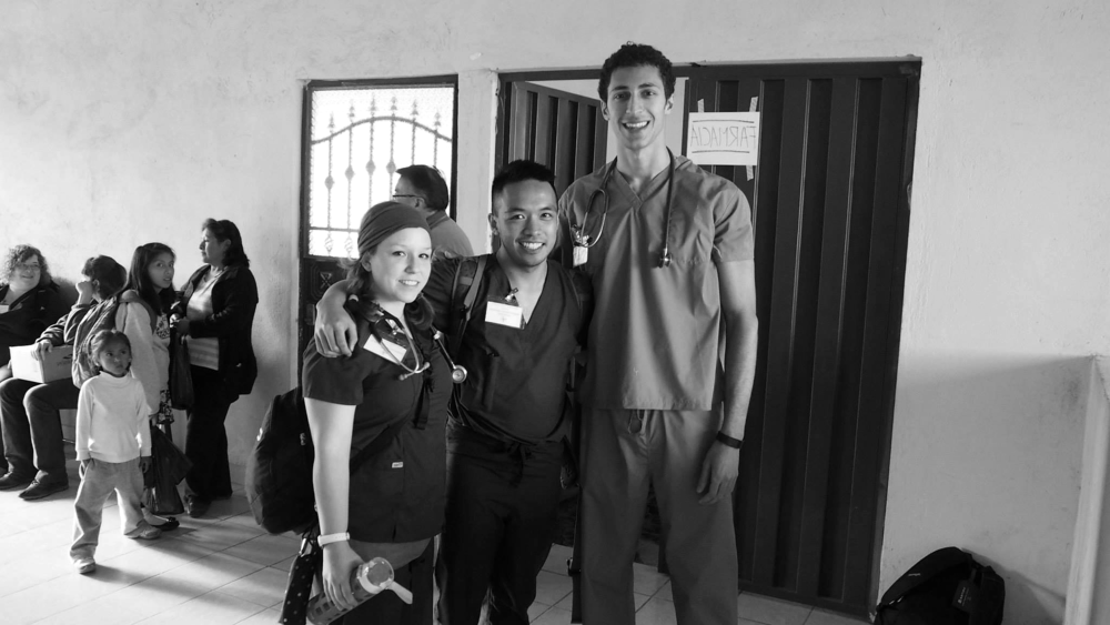 Chelsea Stewart, Robert Guidangen, and Bahrom Firozgary (M2s) wrap up a great work day at the clinic in Guamaní, Ecuador.