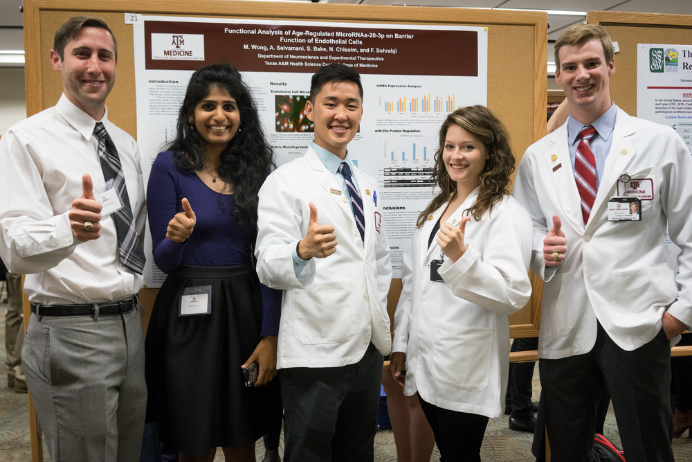 """Texas Brain & Spine Institute Summer Research Program 2015"" L to R: David Szynkarski, Sneha Konda, Marcus Wong, Danielle DeBacker, Richard Nauert (M2s)"