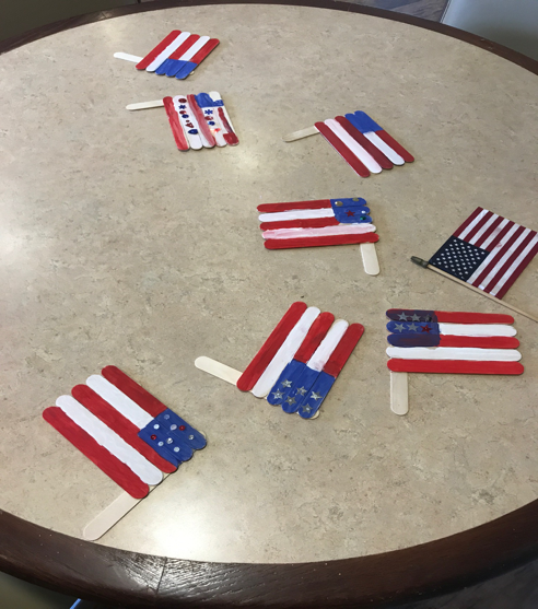 Crafted popsicle stick American flags. Photo by Rahul Devroy, M3.