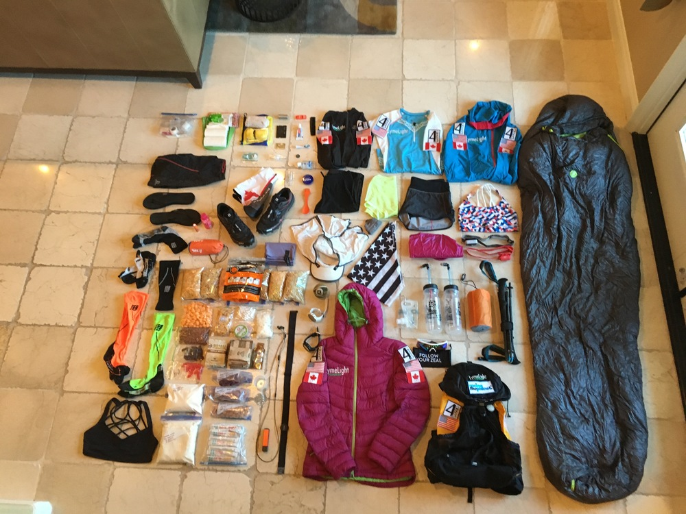 Image provided by Jax of all of the items that fit in her 18lb pack while she runs each event!