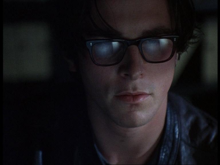 Arthur Stuart (Christian Bale) heavily immersed in research.