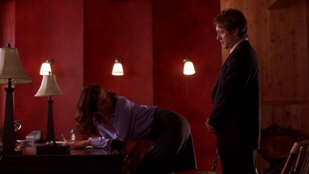 Submissive secretary Lee (Maggie Gyllenhaal) and her boss/Dom/lover Mr. Grey (James Spader) in Steven Shainberg's  Secretary  (2002).