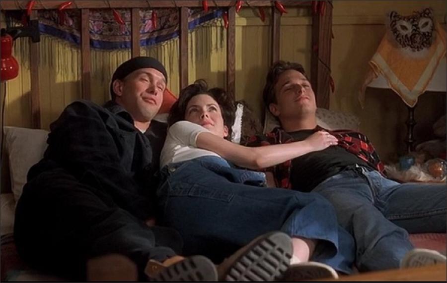Stuart (Stephen Baldwin), Alex (Lara Flynn Boyle), and Eddy (Josh Charles) get cozy in  Threesome .