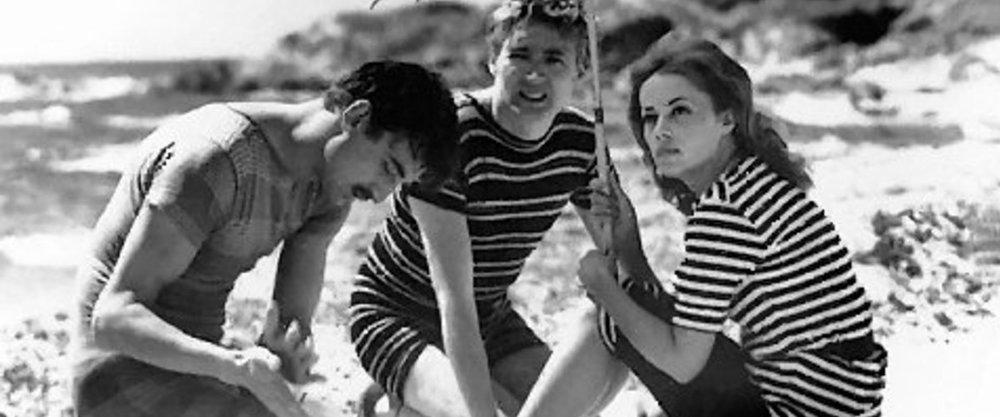 François Truffaut's iconic love triangle: Jules (Oscar Werner), Jim (Henri Serre), and Catherine (Jeanne Moreau) in  Jules et Jim  (1962).