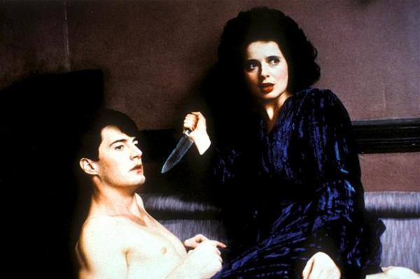"Do You Want To Do Bad Things?: BLUE VELVET And The Necessary Terrors Of Self-Discovery - by Drew Dietsch""This fixation eventually crosses over into an outright sexual dynamic between Jeffrey and Dorothy, and it is where Jeffrey realizes that his compulsion to watch has led him to a point where he is made to act. During their first encounter when Dorothy discovers Jeffrey in her closet, she performs oral sex on him while threatening with a knife. This power play continues the danger that Jeffrey associated with his voyeurism, but he is now rewarded with sexual gratification. When they meet again, Dorothy reveals her masochistic side and demands that Jeffrey hit her. When he finally concedes, he has crossed over into the darkness that he only watched from a safe enough distance."""