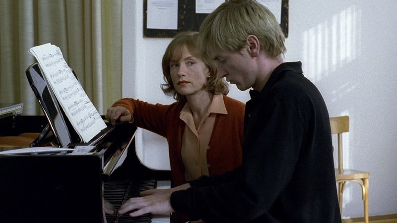 Erika (Isabelle Huppert) eyes her newest pupil, Walter (Benoît Magimel) in Michael Haneke's  The Piano Teacher  ( La Pianiste,  2001).