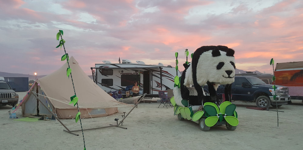 The playa pandas set up camp around 3:15 and G every year. You can find us when you see the green lit bamboo forest that marks our home. Come and visit us!