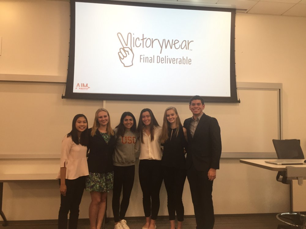 Consultants presenting to the founder of Victorywear. (L-R: Dani Toda, Emily Moneymaker, Victorywear representative, Emily Heuring, Emma Hunter, Josh Hunt).