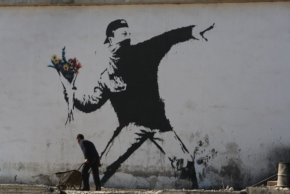 Banksy Flower Throw.jpg