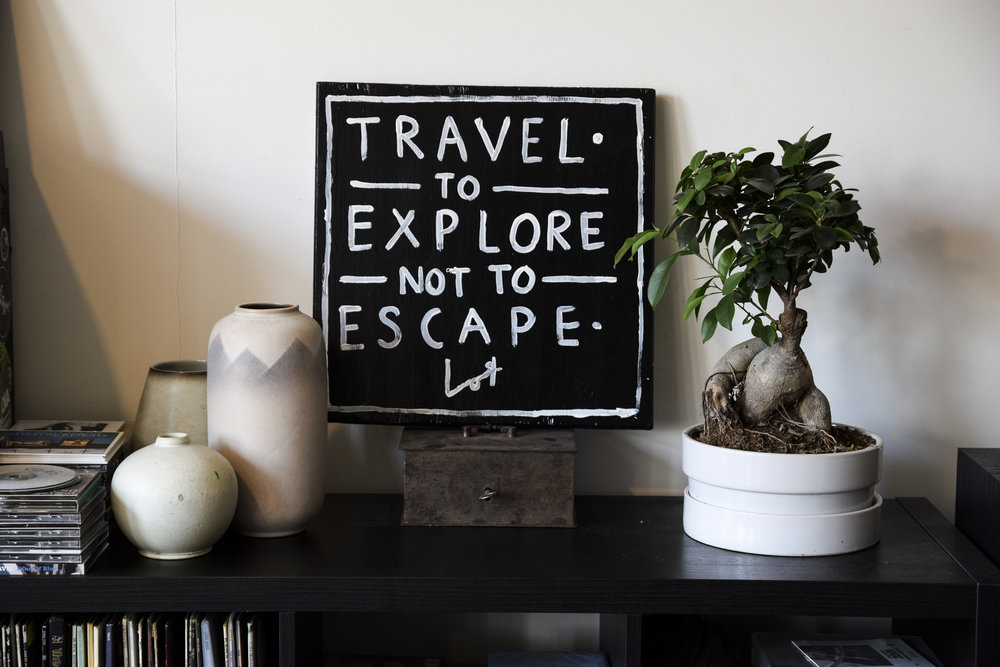 "Item: Lot Madeleine ""Travel to Explore, Not to Escape"" Photo: Travis Hatridge"