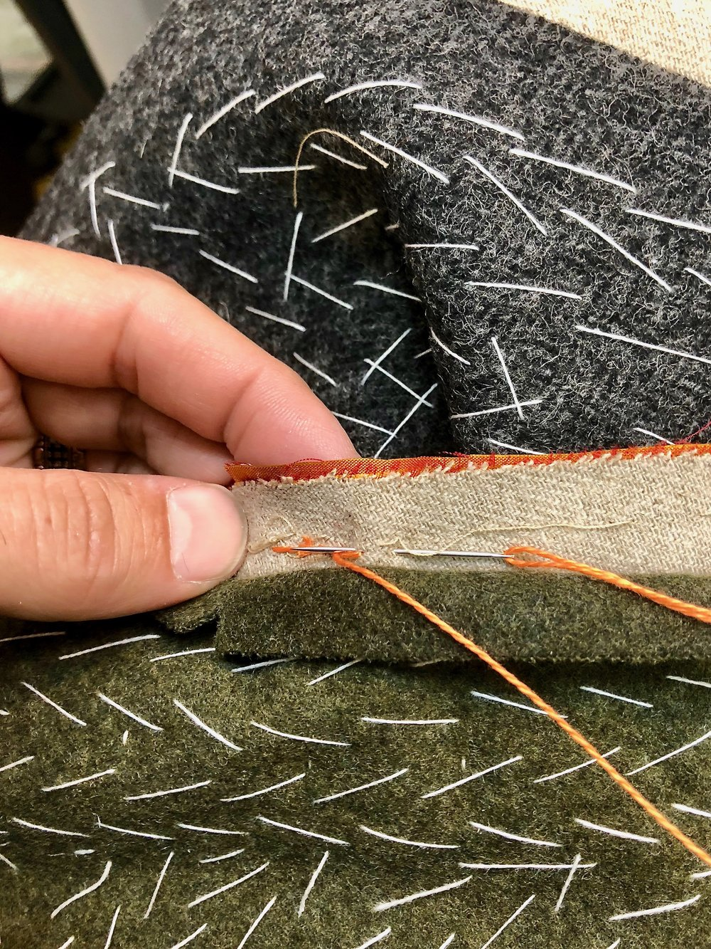 Back-stitching the side-back seam on a handsewn silk doublet.