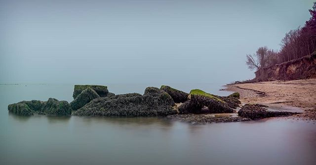 A WW2 Gun/Observation post lays at the mercy of each and every high tide after coastal erosion slowly but surely consumes the cliffs. You can see yet trees on the beach behind and more falling to their fate. (It's panoramic so probably needs a click and tilt to see in full)  I had a bit of a battle processing this one but I've finally captured the mood of the beach on a rather murky East Mersea Island at Cudmore Grove. This beach certainly suits the moody shots over the pretty sunrises.  #landscapephotomag #landscape #ukpotd #mersea #ww2 #seascape #osmaps #beach #essex #ukphotography #picoftheday #picoftheweek #lpoty #opoty #essexcoast #history #coastalerrosion