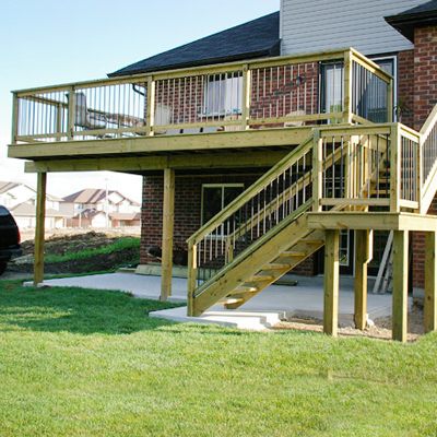 SIMPLE ELEGANCE   Elevated decks don't have to look like awkward add-ons. This two-tier deck takes advantage of a basement walkout and provides the perfect space to enjoy that view.