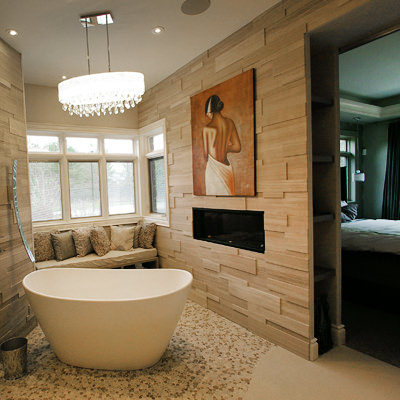BRINGING NEW LIFE TO YOUR ENSUITE   Transforming outdated master bathrooms using today's materials and fixtures can rejuvenate a house. This master bathroom creates a dramatic statement and is a relaxing getaway.