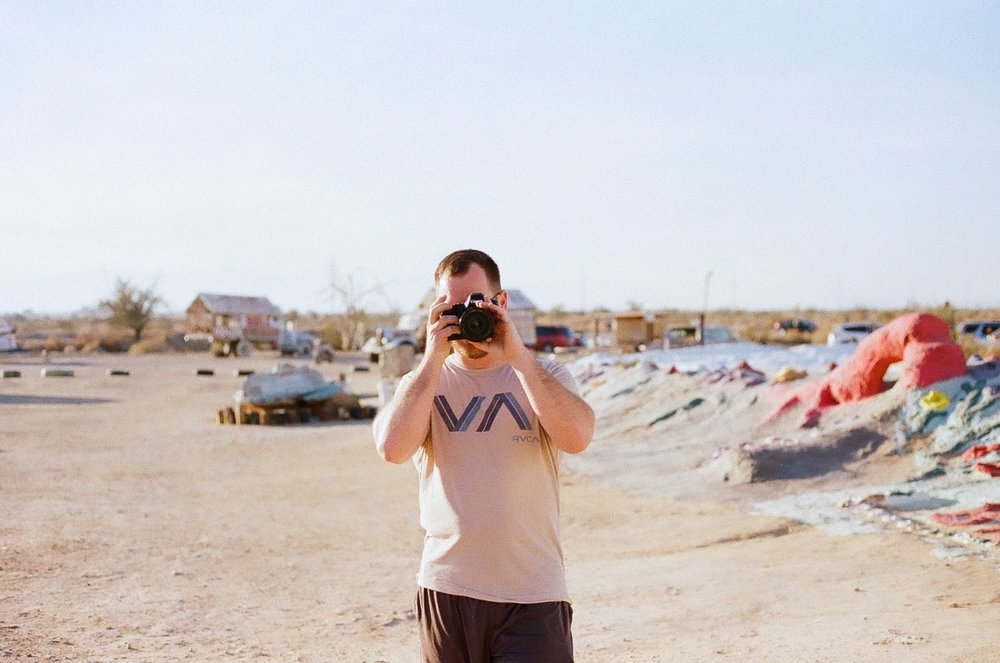 Hubby taking a photo of me at Salvation Mountain because I have waited like 8 years to go.