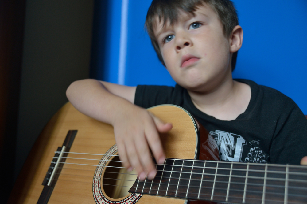 "This is his ""I'm a serious songwriter"" look. Not for family portraits, son. Please. : )"
