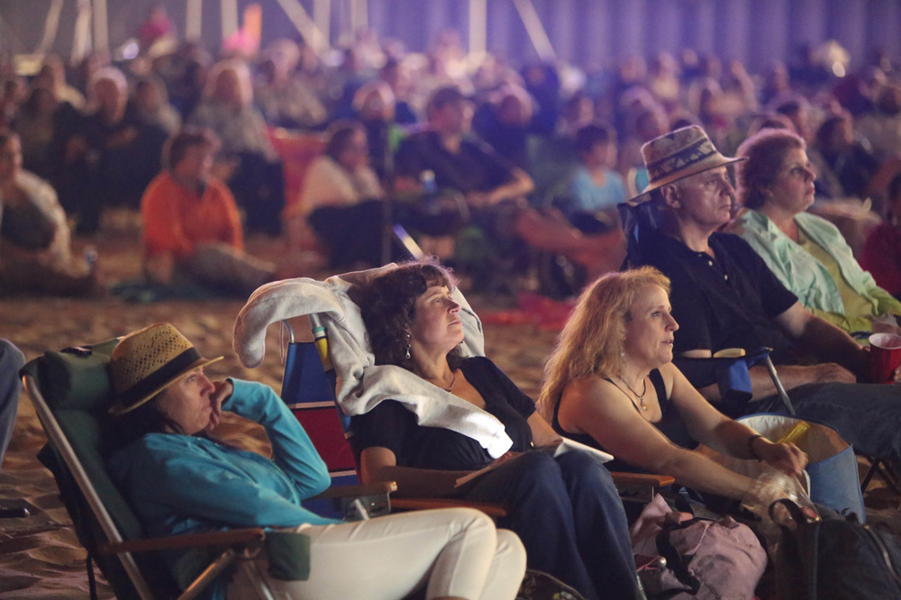 AUDIENCE IN BEACH THEATRE WATCHING SHORTS ON THE BEACH