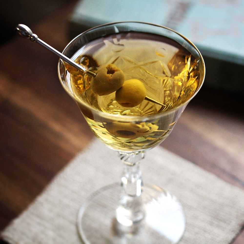 Dirty Martini 2.5 oz - Gin or vodka .5 oz - Dry vermouth .5 oz - Olive brine Add all the ingredients to a mixing glass filled with ice. Stir, and strain into a chilled cocktail glass. Garnish with 2 olives.