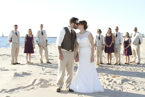 Pere Marquete beach was a beautiful spot to take the bride and groom in Muskegon. The wedding party seemed to enjoy themselves on the beach as well (especially chasing the seagulls). © 2014 Shealyn McGee-Sarns
