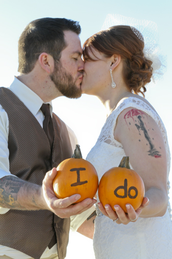 Knowing that this was an October wedding, I wanted to have a little bit of fun with props and picked up these pumpkins. © 2014 Shealyn McGee-Sarns