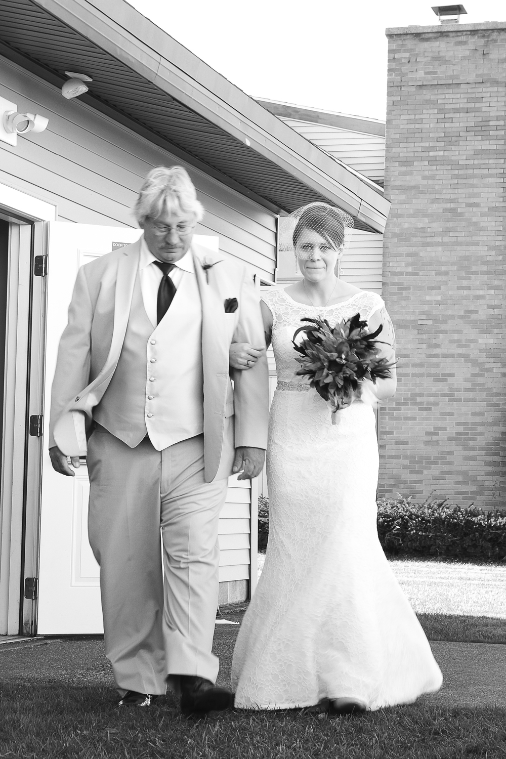 The bride and her dad on their way to the aisle. © 2014 Shealyn McGee-Sarns