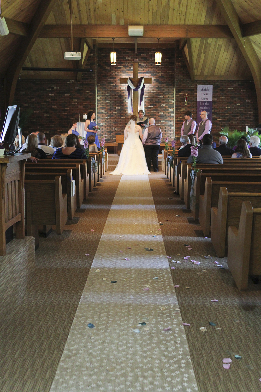 Something about the lighting in this church just made these photos almost magical! I loved the brick walls and the wooden ceiling. © 2014 Shealyn McGee-Sarns