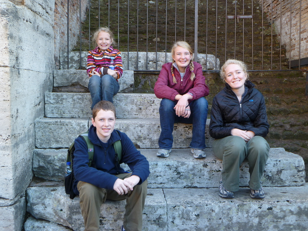 "This is a picture of our children on the steps of the Colosseum in Rome, Italy in 2011.  In the Fall of 2011, our family spent time in Ukraine, and then traveled to England, France, Germany, Greece, Italy, and Spain.  This was our ""trial run"" for a 2015 'Round the World Trip.  We love to see the world, but Ukraine will always feel like home."