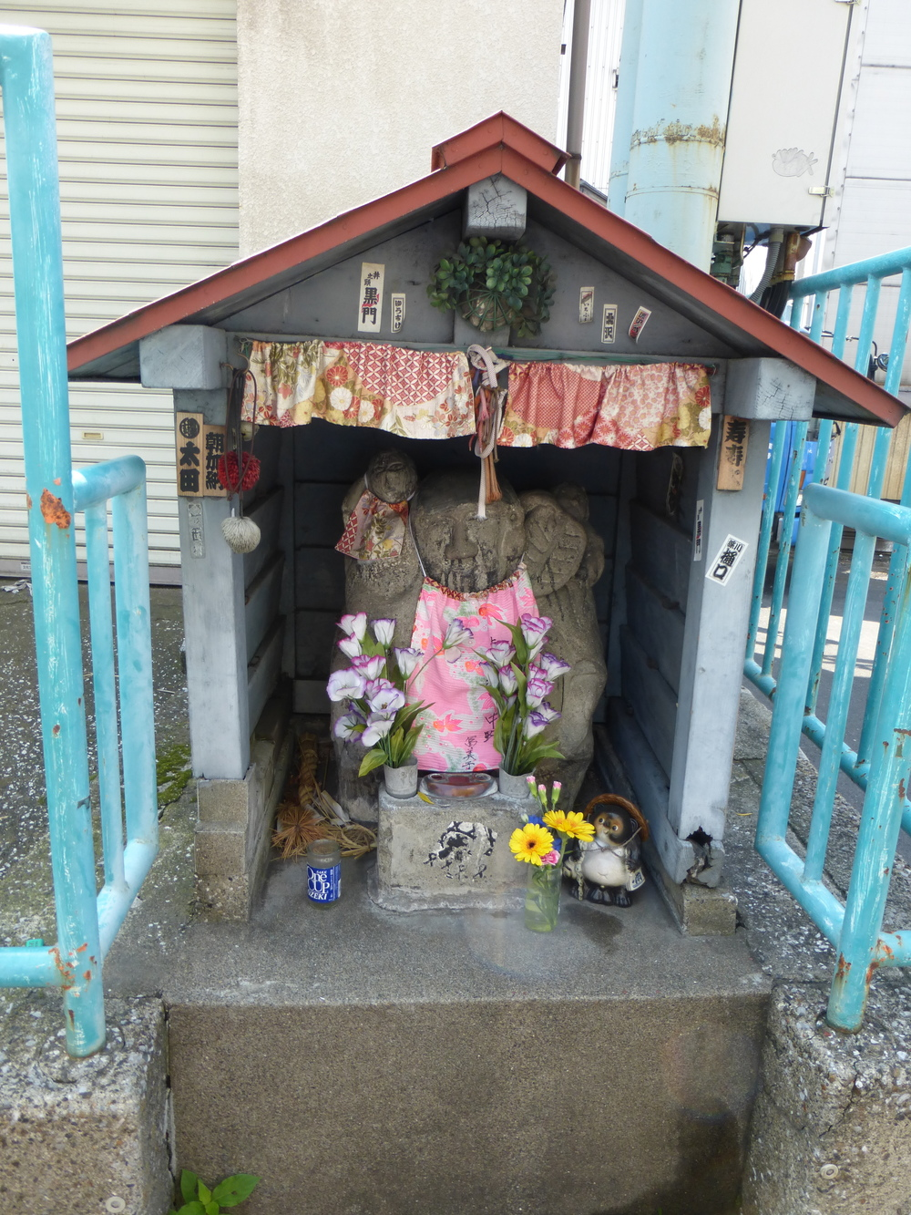 This is a picture of a good luck shrine that the fishermen touch as they go out to sea or to sell their fish for the day.    They have a lot of shrines and burn incense to get good luck here.