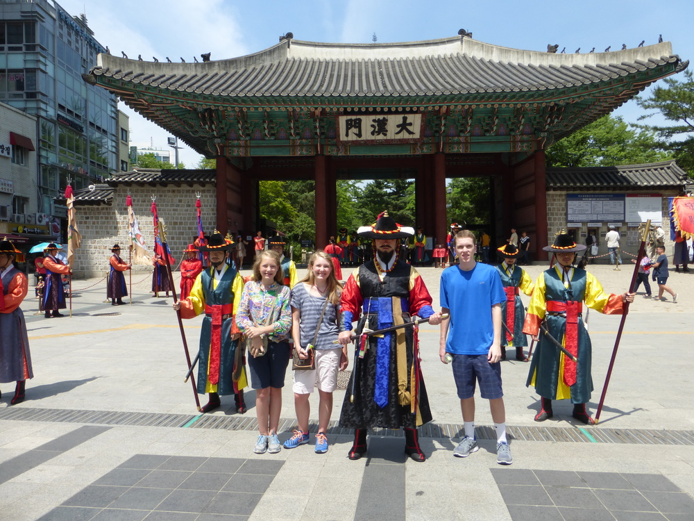 The kids with some of the guards at the changing of the guard ceremony at the Deoksugung Palace.  It lasted 10 minutes and they did fun things like playing sea shells as instruments.