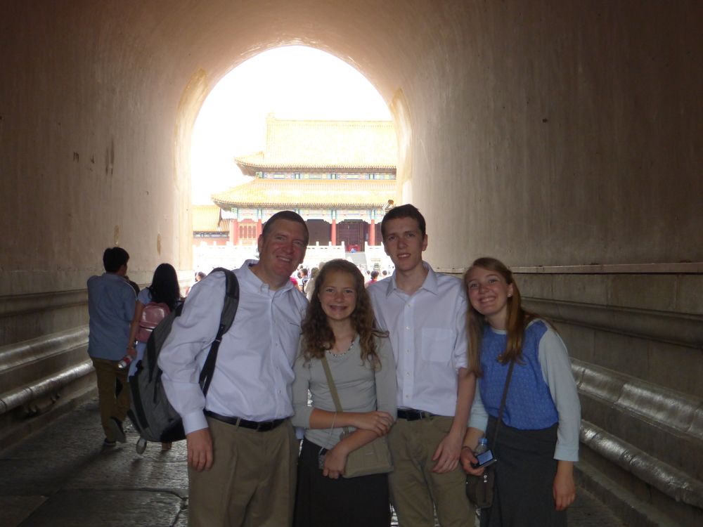John and the kids in side a tunnel going through the gate to the Forbidden City.