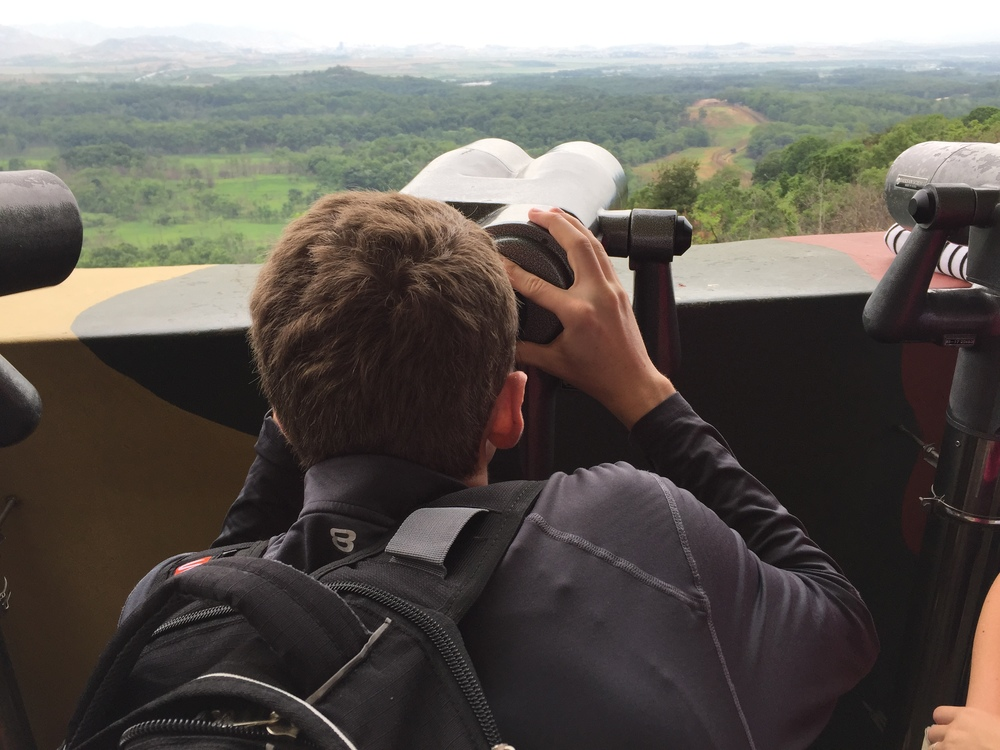 Joseph looking into North Korea from the DMZ