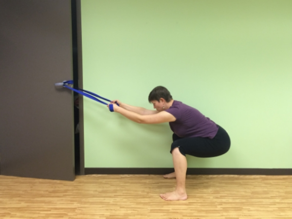 Strap Squat - wrap a yoga strap around a door knob and use it to help balance yourself as you keep your shins vertical in your squat, use this to lower down part way or all the way down into a full squat, be mindful not to bear down or hold your breath