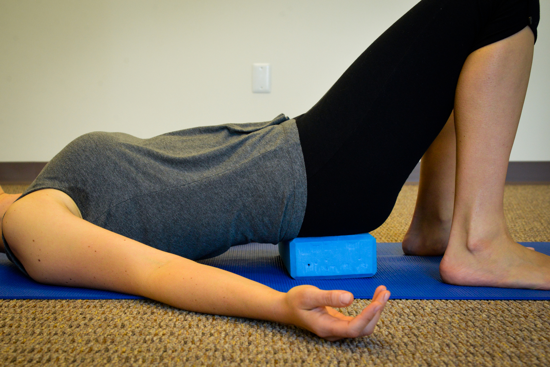 psoas release and hip flexor stretch on yoga block