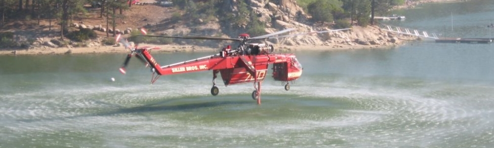 Water-dropping helicopter refilling for another attack on the 2007 Butler fire (Photo by _____ Stuart)