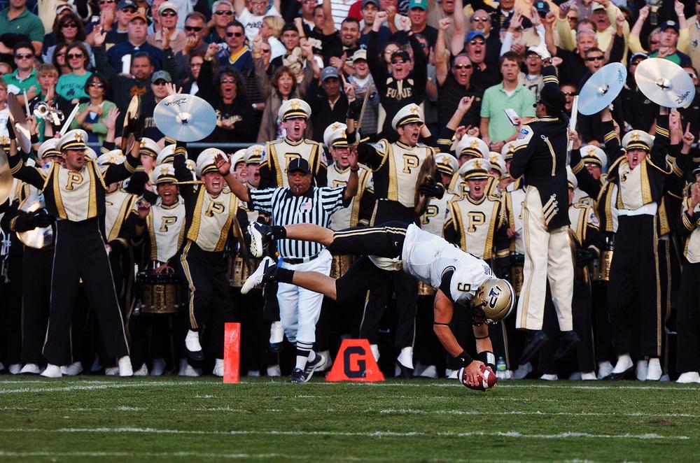 Purdue quarterback Robert Marve leaps into the end zone against Notre Dameat Notre Dame Stadium on Sept. 8, 2012.