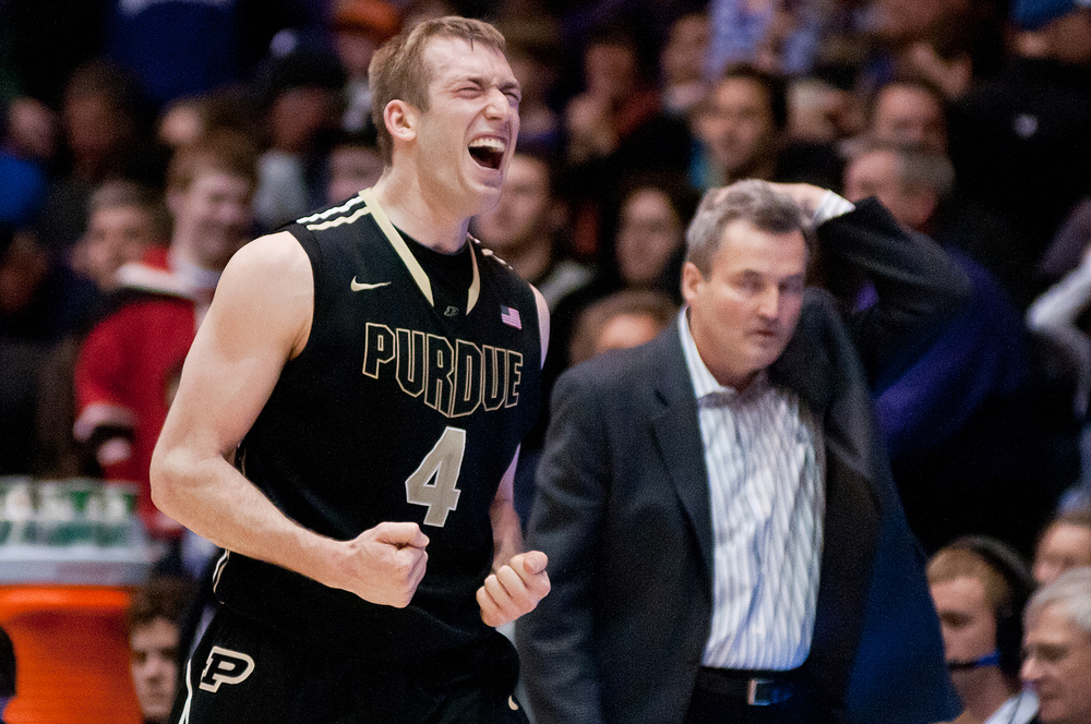 Winners and Losers:Purdue forward Robbie Hummel and Northwestern headcoach Bill Carmody at Welsh-Ryan Arena.