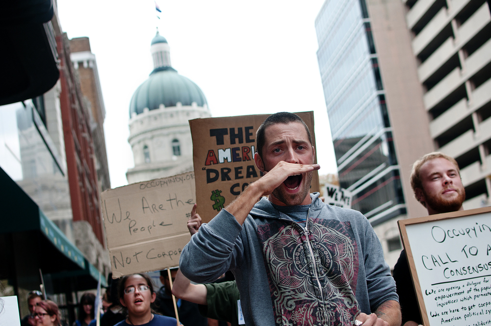Occupy Indianapolis protesters march near the state capitol building where former Texas governor Rick Perry payed a visit during his 2012 presidential campaign.