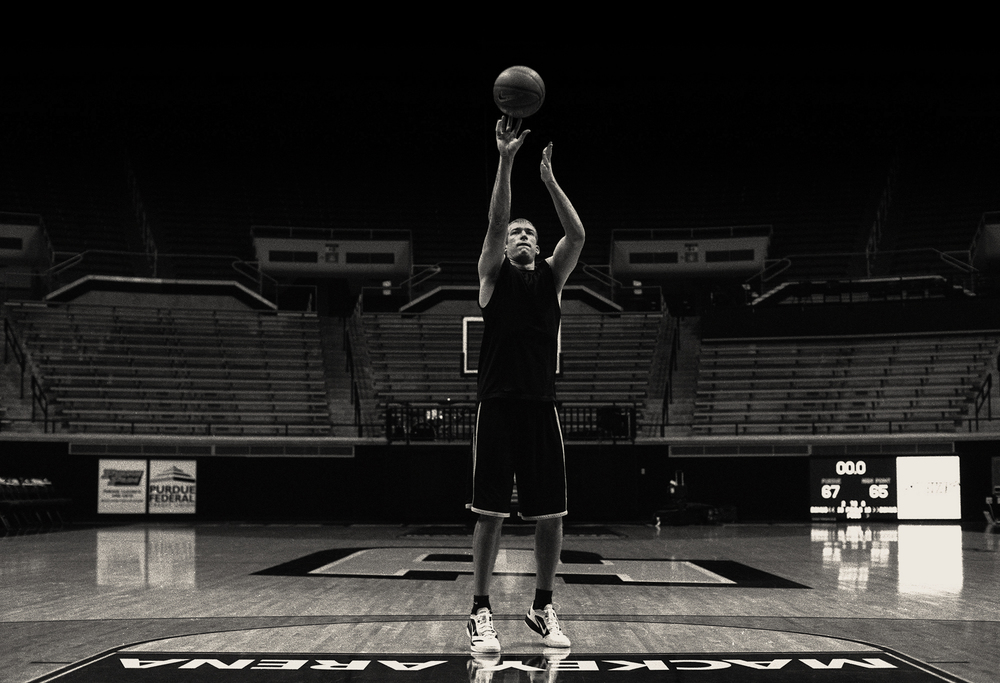 """In an empty Mackey Arena, Purdue forward Robbie Hummel practices free throws late into the night following a close win against High Point.""""I missed three or four free throws at the end of the game, we almost lost. It drives me crazy,free throws,"""" Hummel recalls .  Ilford HP5+ iso400 push 2 stops."""