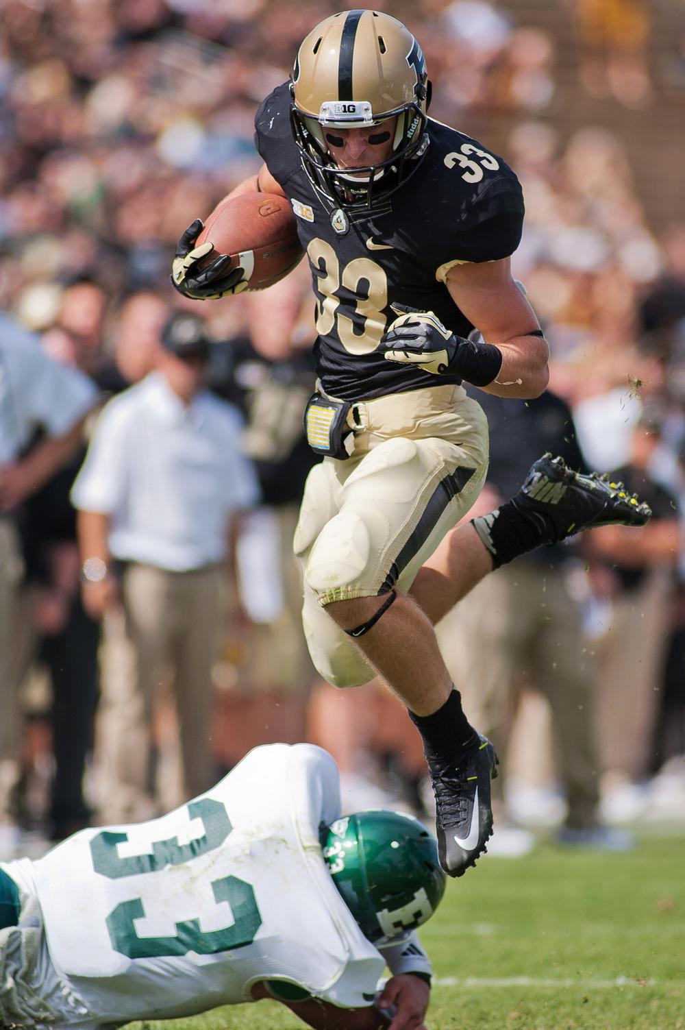 Purdue wide receiver Danny Anthrop leaps over Eastern Michigan's defense in Ross-Ade Stadium Sept. 15, 2012.